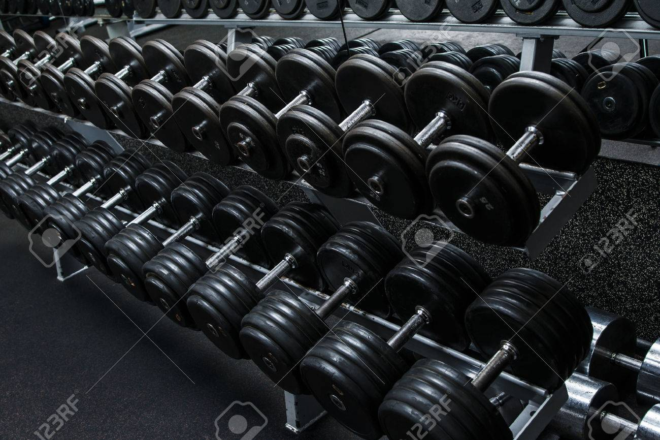 Various dumbbells in gym - 56643813