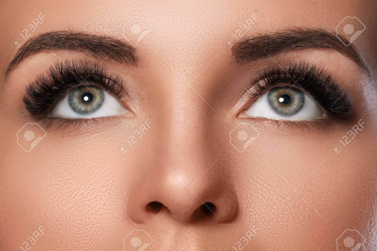 Female face with beautiful eyebrows and artificial eyelashes for maximum volume - 104650836