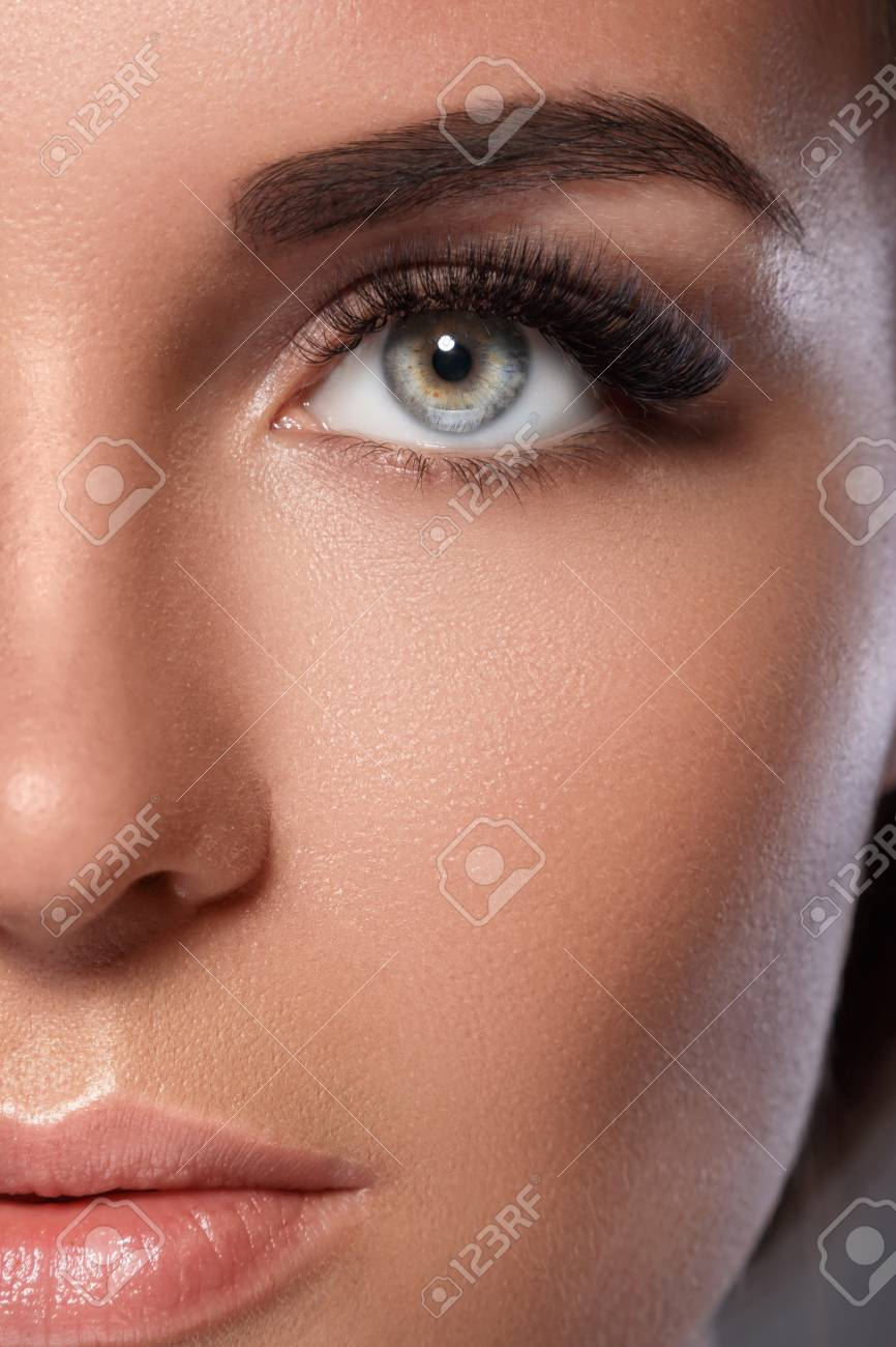 Female face with beautiful eyebrows and artificial eyelashes for maximum volume - 104366555