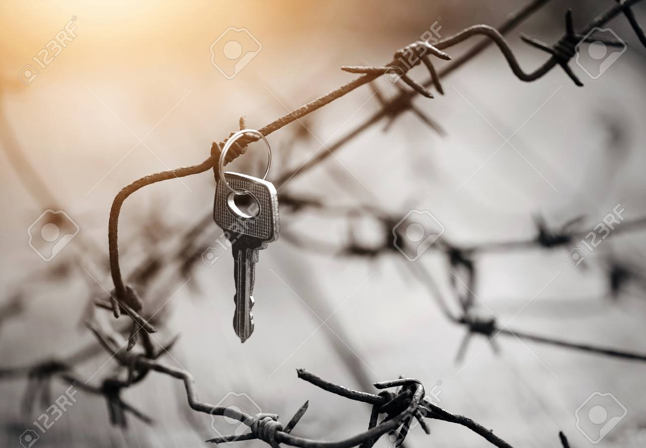 The Key Hangs On A Rusty Barbed Wire. Stock Photo, Picture And ...
