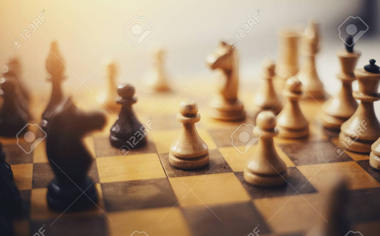 Chess pieces on the Board. Wooden chess pieces on the chessboard. Intellectual game -chess. - 133288614