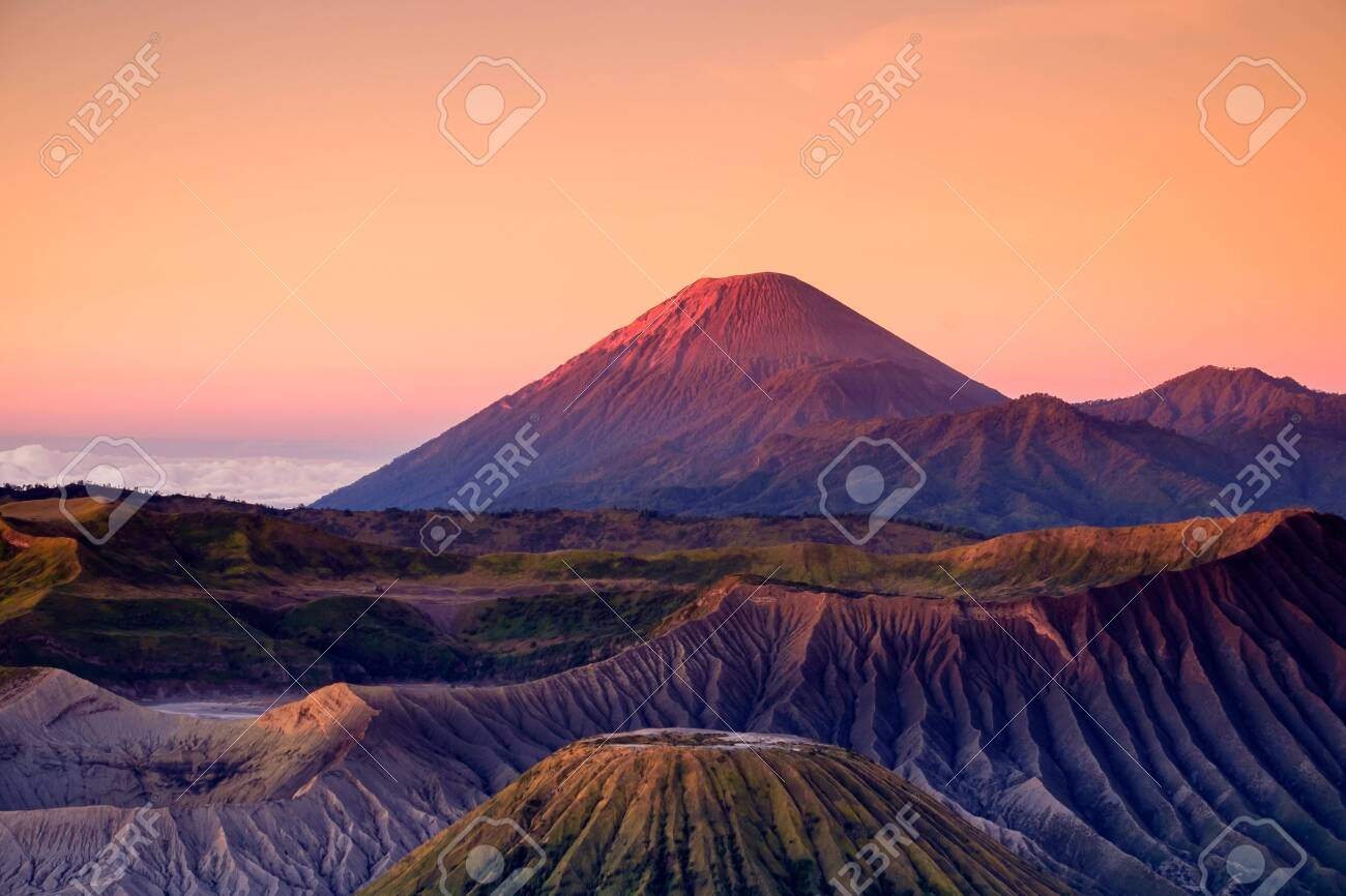 The beautiful sunrise at Mount Bromo volcano, the magnificent view of Mt. Bromo located in Bromo Tengger Semeru National Park, East Java, Indonesia.Image contains noise grain and blurry. - 129134792