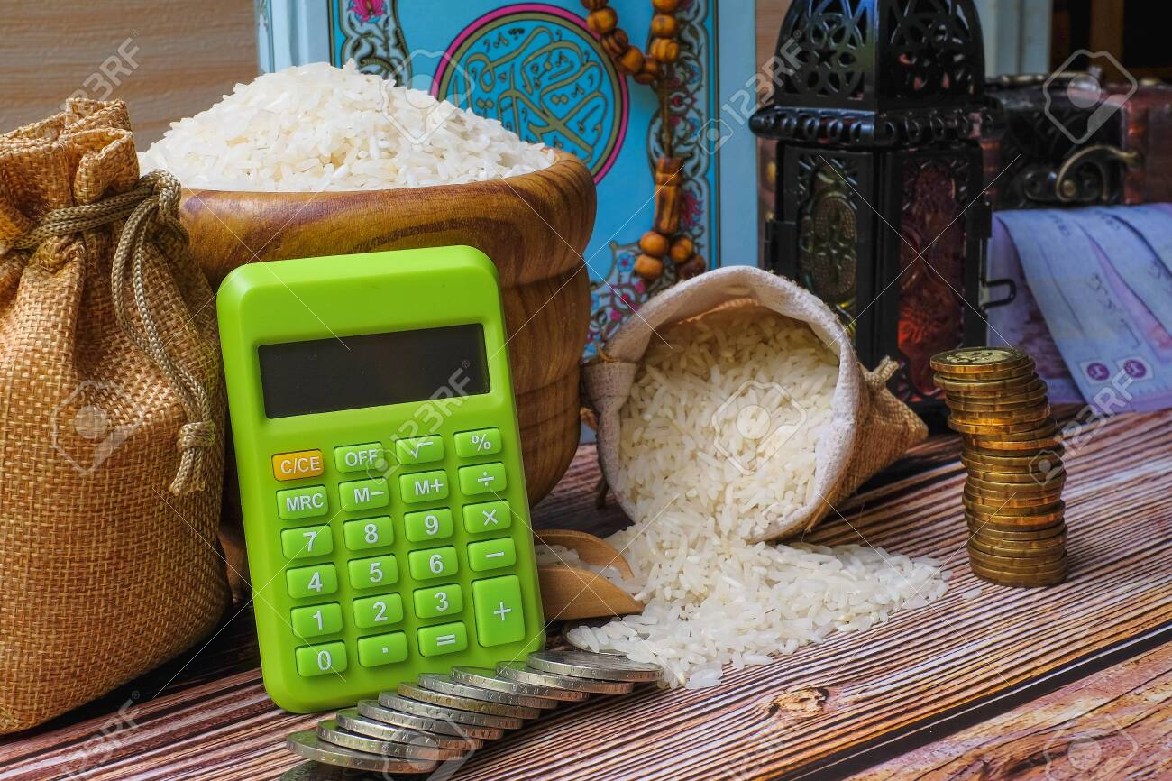 zakat word coin stacked calculator quran and rice on stock photo picture and royalty free image image 147173023 123rf com