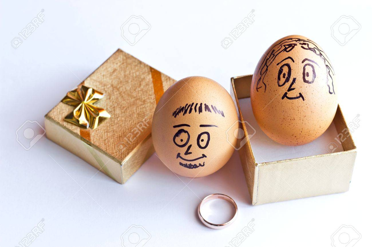 Golden gift box and painted easter eggs with man and woman smiling golden gift box and painted easter eggs with man and woman smiling faces conceptual image negle Images