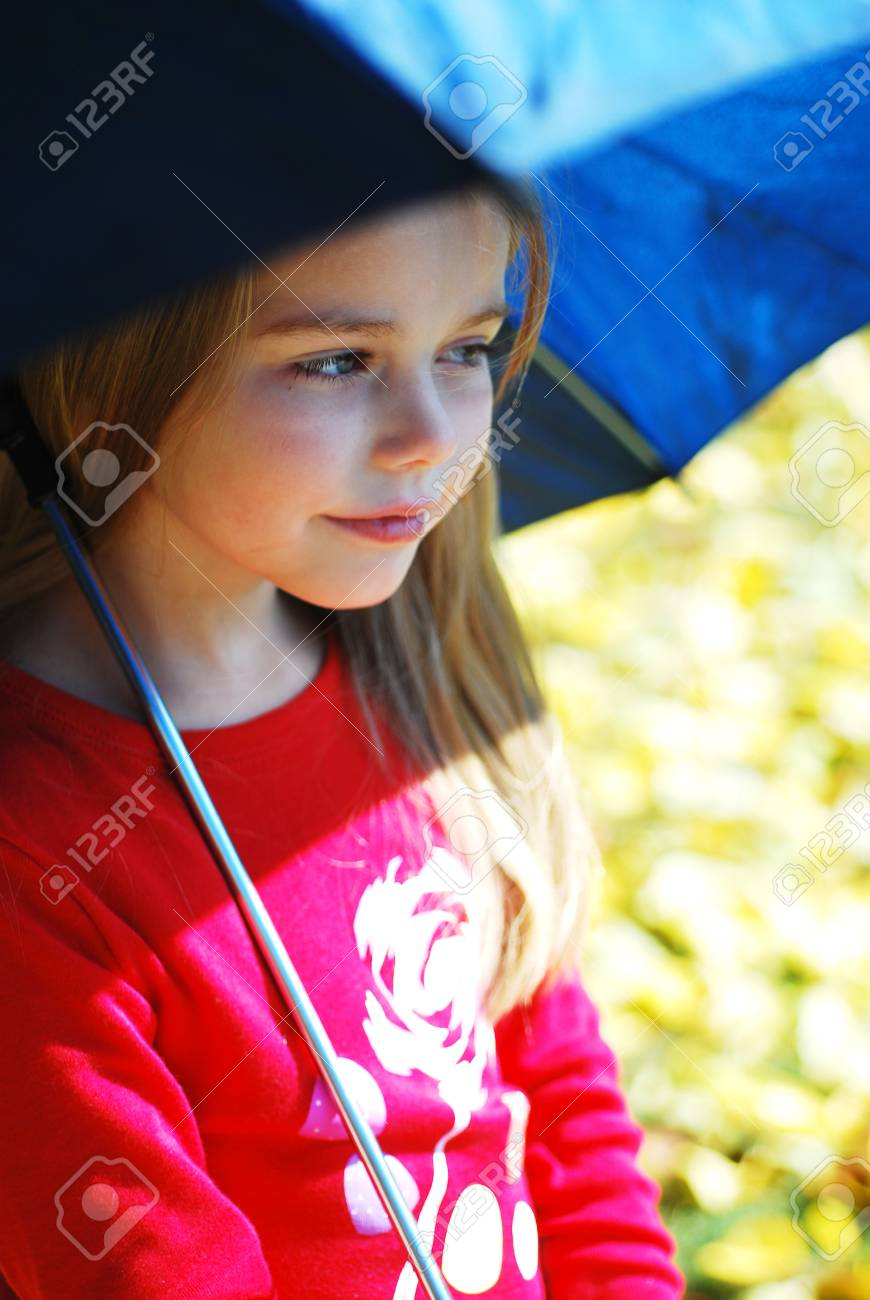 edb03af4509 Girl and umbrella on the street in bad weather of autumn. Stock Photo -  31497186