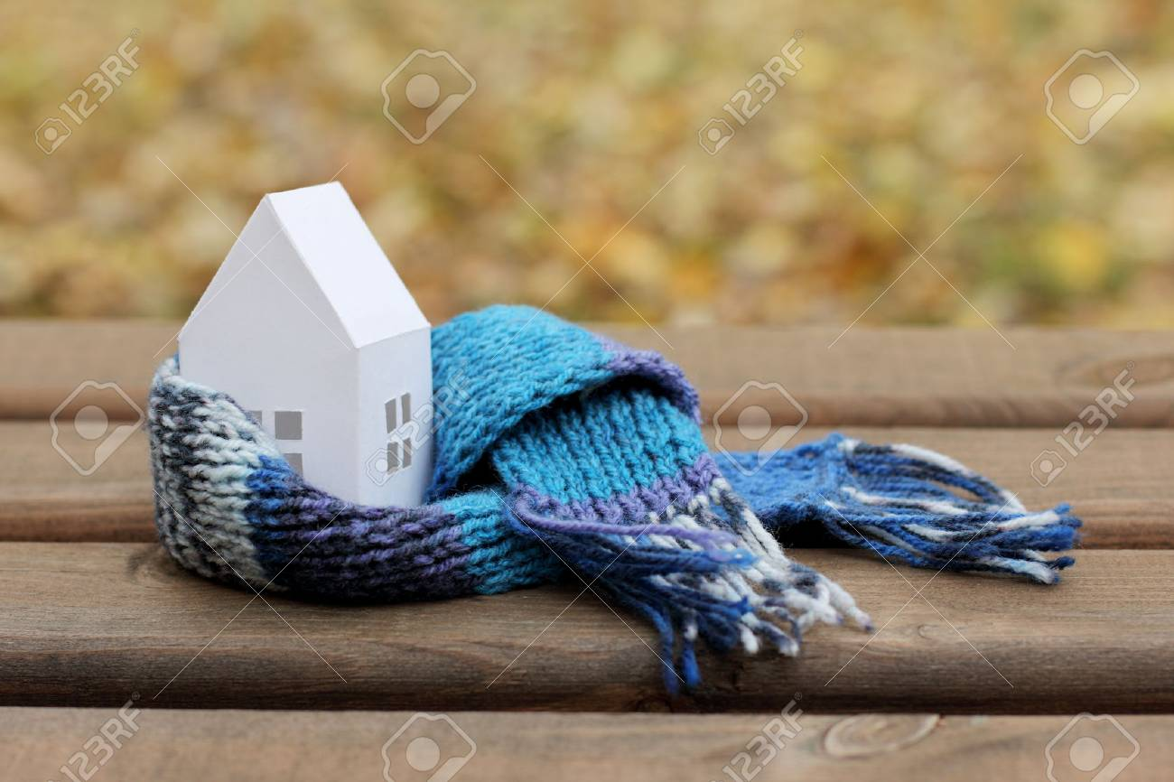 concepts with comfortable insulated house soft scarf on autumn background / time to warm the home - 69685233