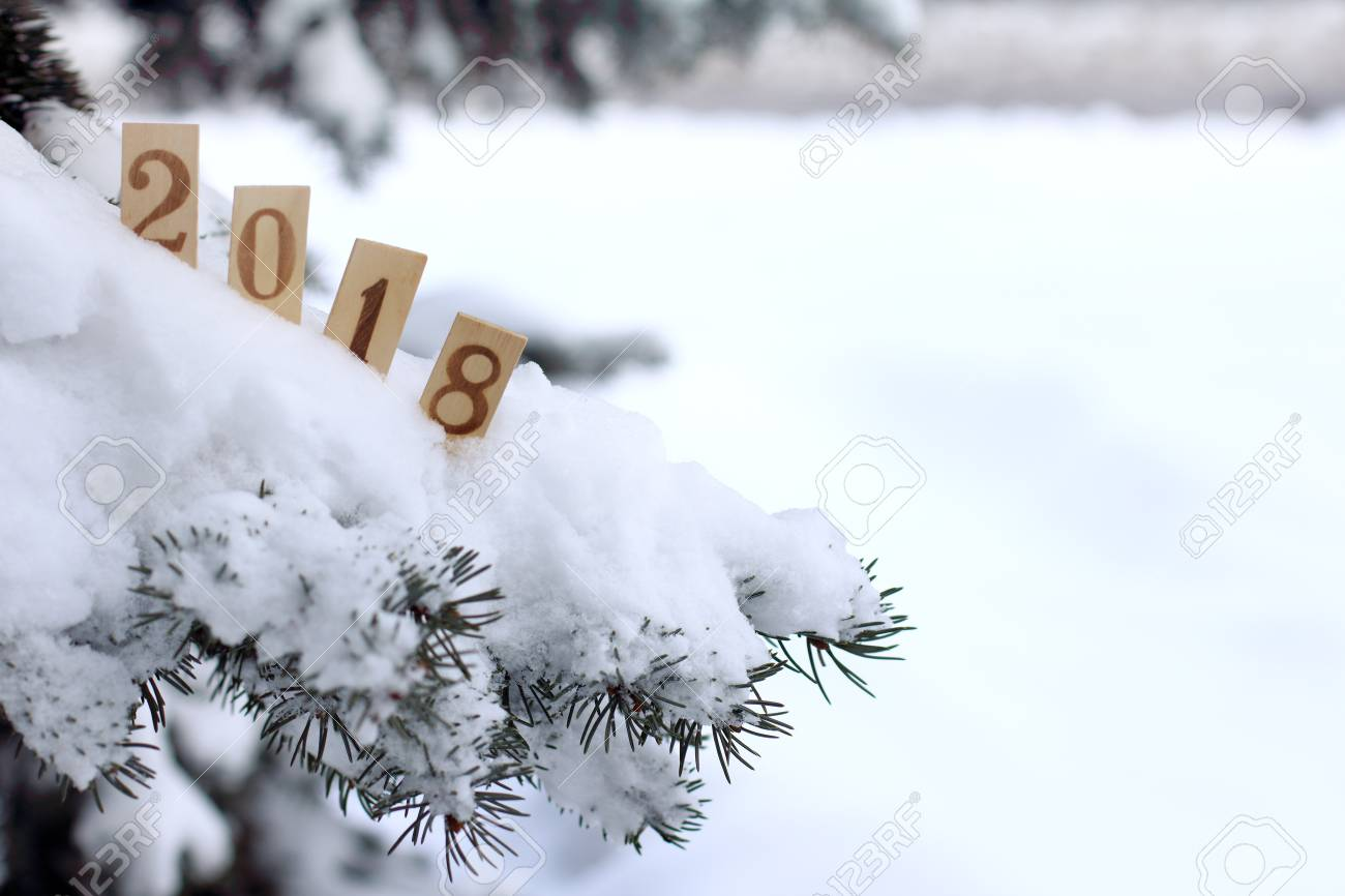 Snow-covered Christmas Tree Decorated With Wooden Numeric That ...