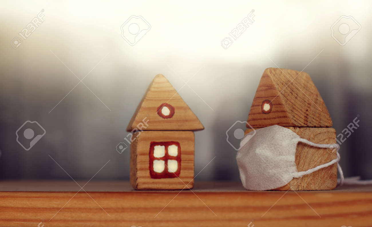 two wooden houses, one of which is masked. personal protection - 171352490