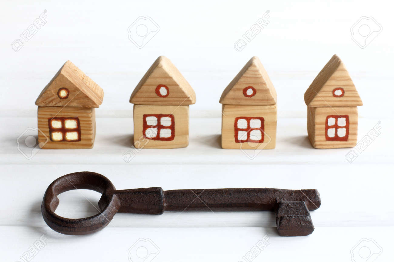 very big key on the background of wooden houses. free spaces for individual accommodation - 171299080