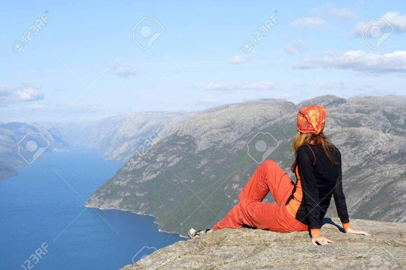 girl hiker sitting on a brink rock and looking at the mountains Stock Photo - 7364677