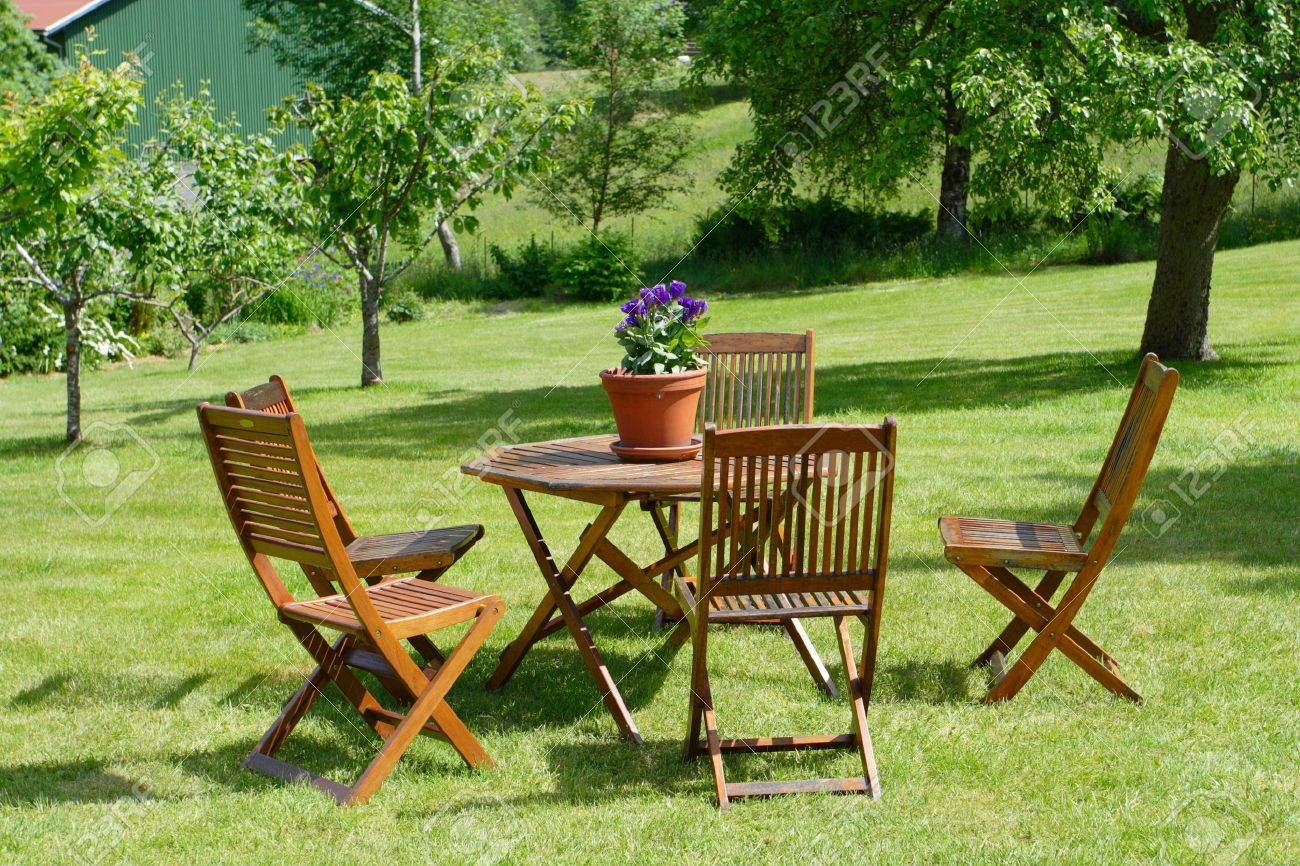 table and chairs standing on a lawn at the garden Stock Photo - 7369220