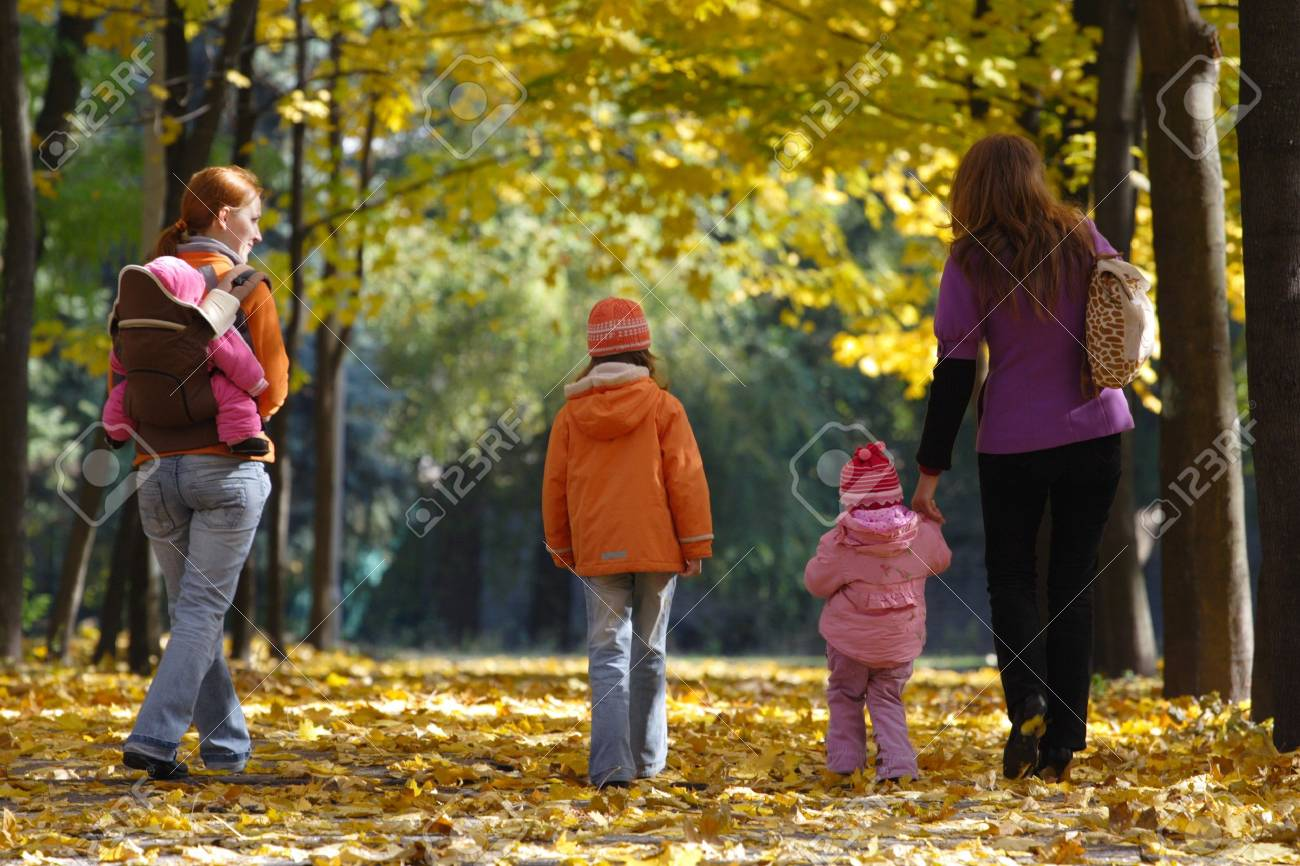 mother with daughters walking at the park Stock Photo - 8245016
