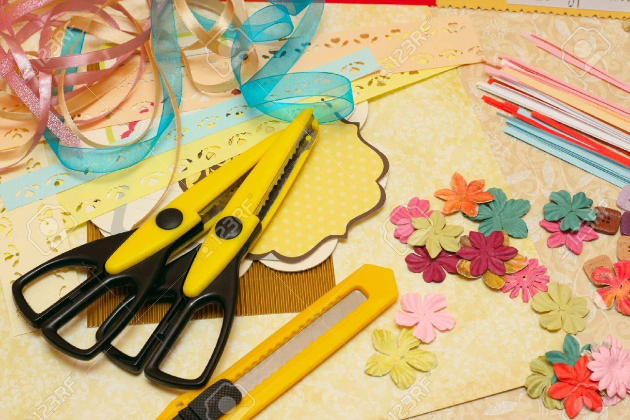 hand made scrapbooking post card and tools lying on a table Stock Photo - 8811799