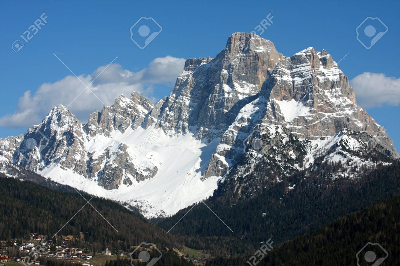 wide green valley with snowed mountains in the distance Stock Photo - 9455949