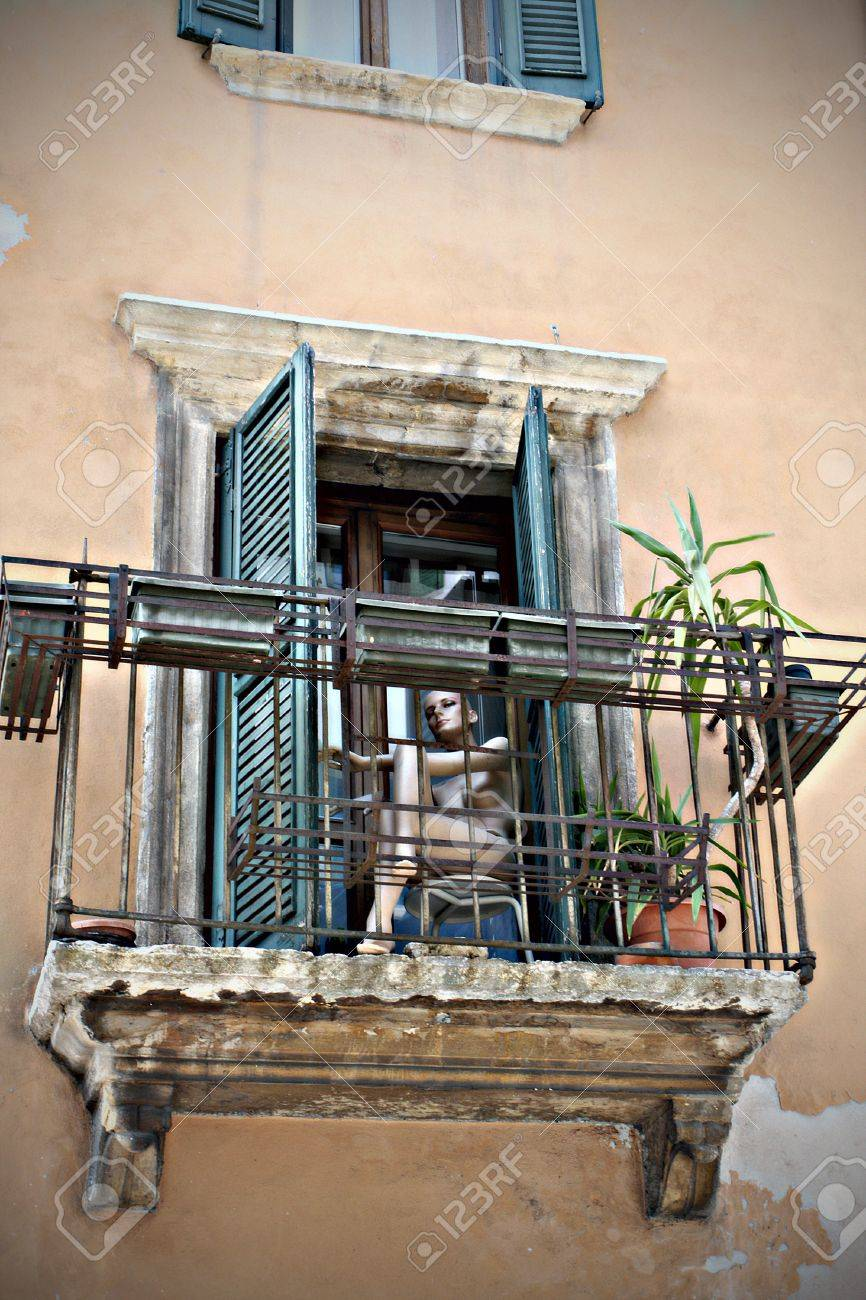 mannequin  sitting on balcony of italian town close-up . Stock Photo - 10640867