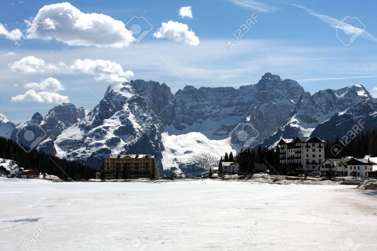 large frozen mountain lake with snowed mountains in the background, italy dolomites Stock Photo - 12522450