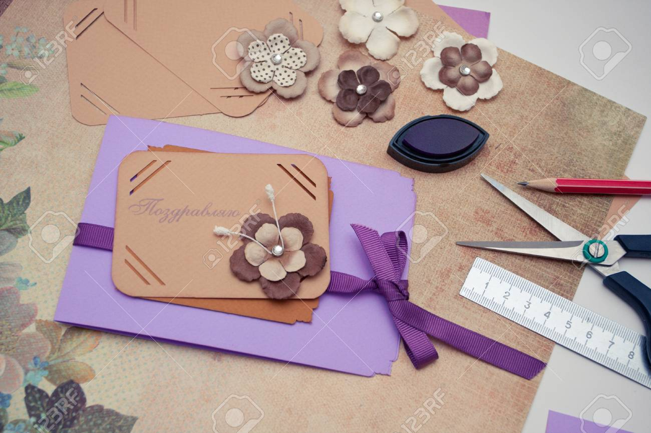 hand made scrapbooking post card and tools lying on a table Stock Photo - 17325924