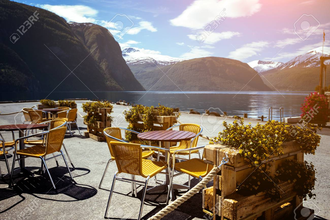 Cafe. Tables And Chairs On The Shore Of The Fjord In Norway Stock Photo