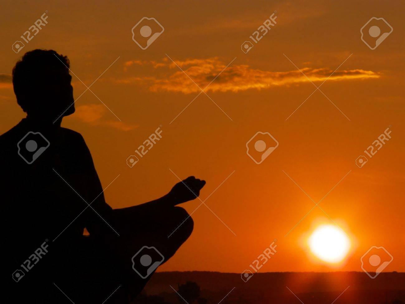 young man meditatin on sunset, vector illustration Stock Illustration - 9894688