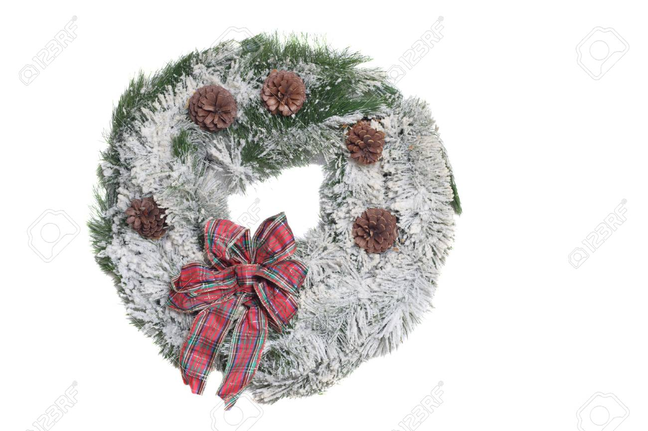 Flocked Christmas Wreath with red bow on a white background. Stock Photo - 642796