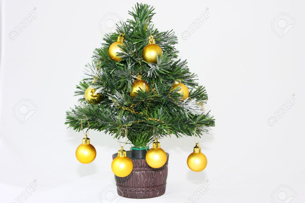 Plastic Christmas Tree.Small Plastic Christmas Tree Isolated On White Background