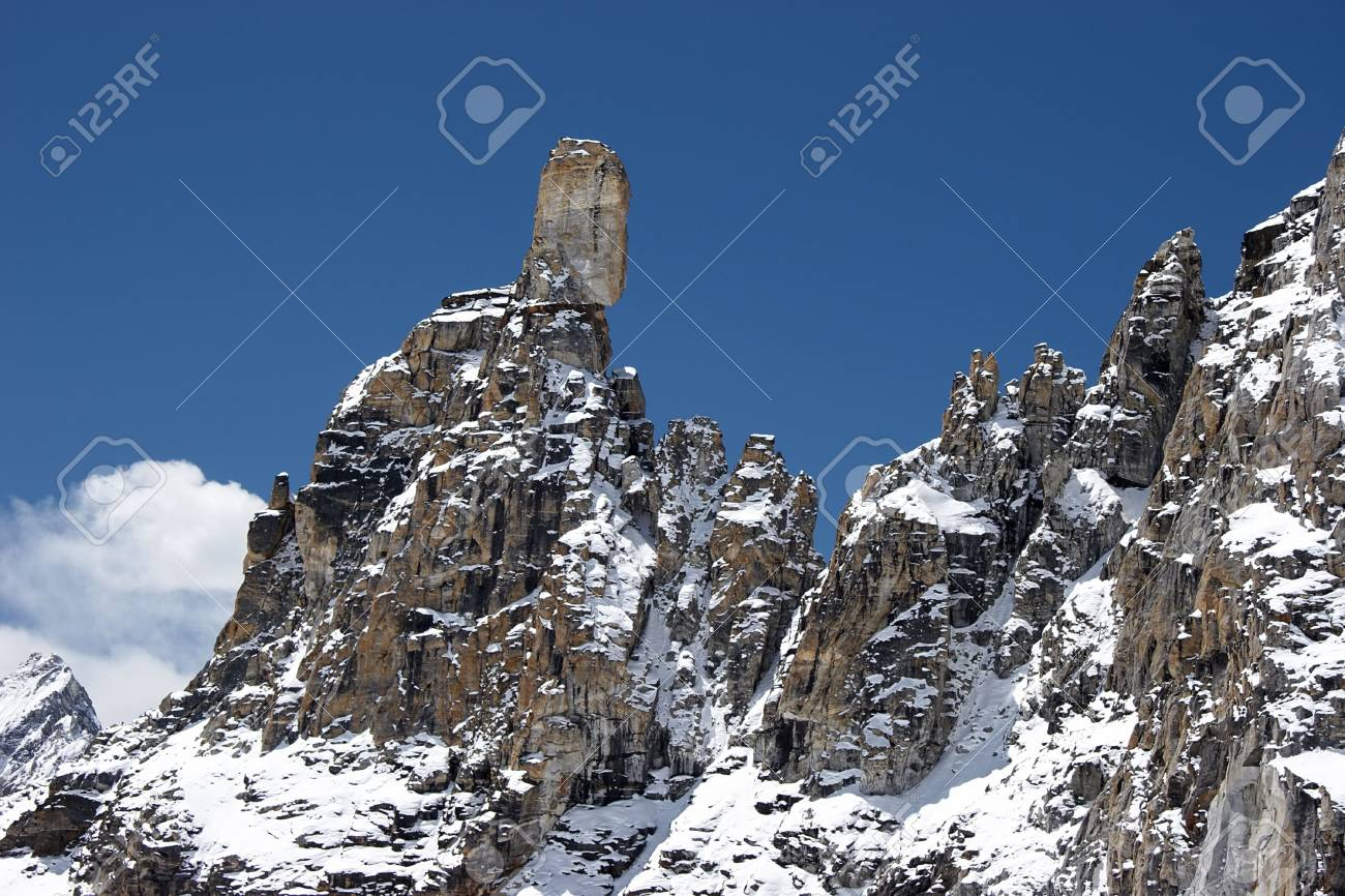 Rocky ridge with giant stone at the top, Himalayas Stock Photo - 5364400