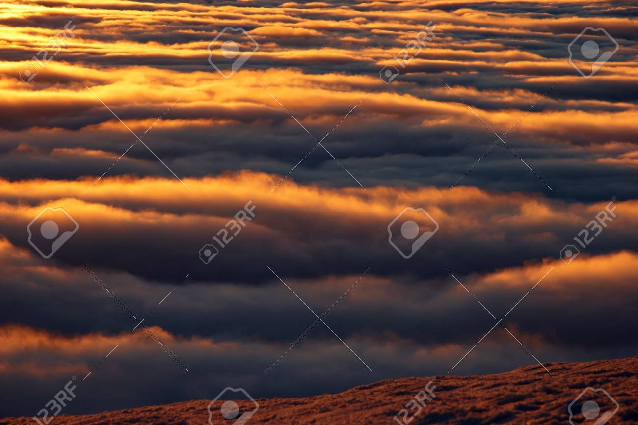 Mountain view of golden clouds at sunset Stock Photo - 6076402