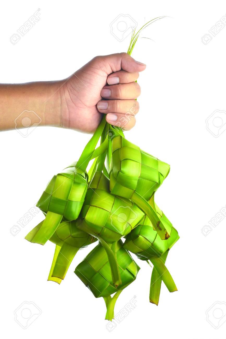 Ketupat (Rice Dumpling). Ketupat is a natural rice casing made from coconut leaf. - 61137508