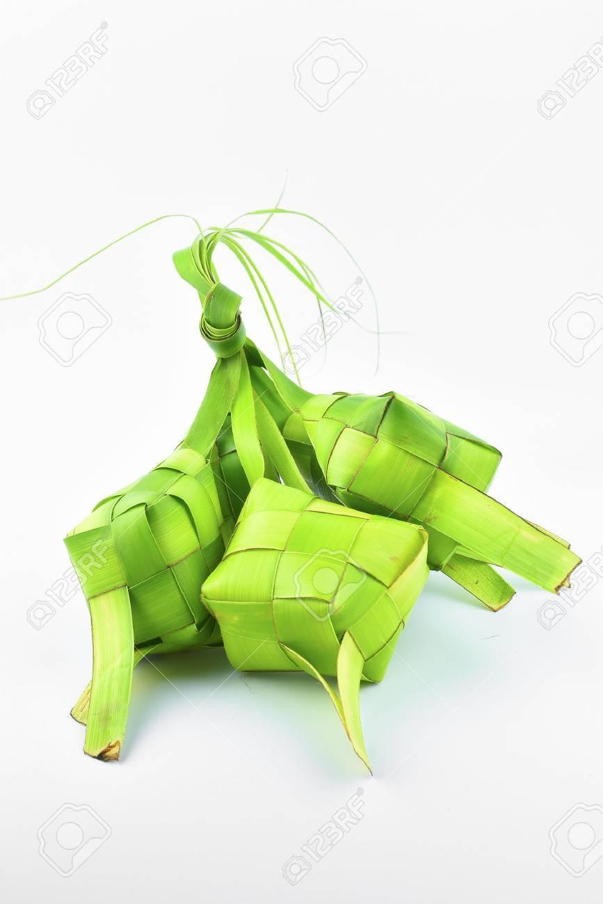 Ketupat (Rice Dumpling). Ketupat is a natural rice casing made from coconut leaf. - 61137313
