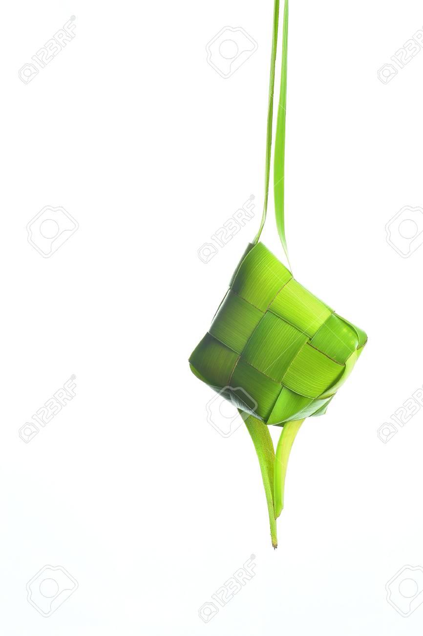 Ketupat (Rice Dumpling). Ketupat is a natural rice casing made from coconut leaf. - 61137316