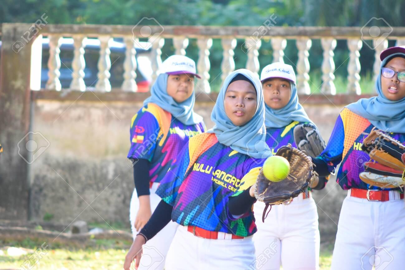 KUALA LUMPUR MALAYSIA,FEBRUARY 25th 2020: Kids plays amateur softball in park. - 142789869