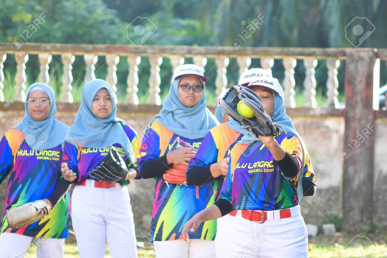 KUALA LUMPUR MALAYSIA,FEBRUARY 25th 2020: Kids plays amateur softball in park. - 142789870