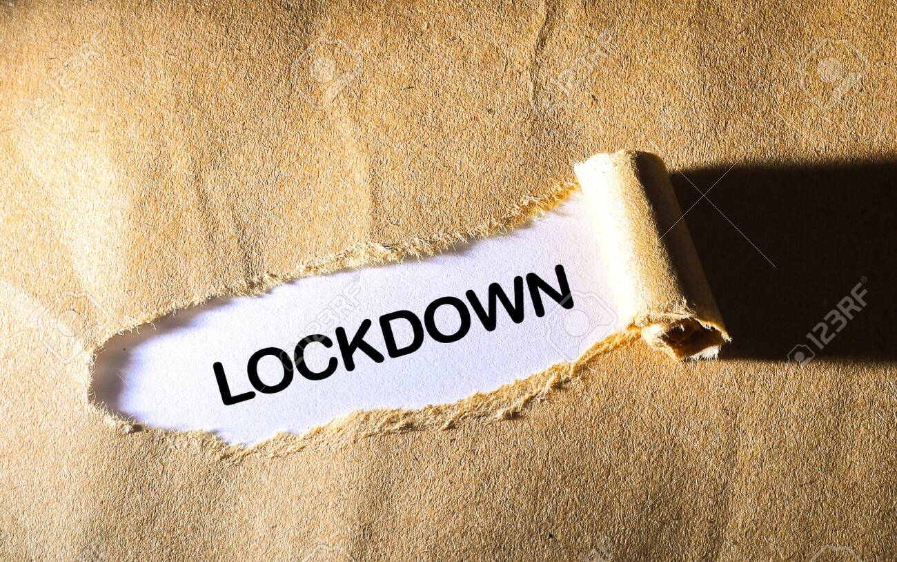 Torn paper with word LOCKDOWN - 143214728