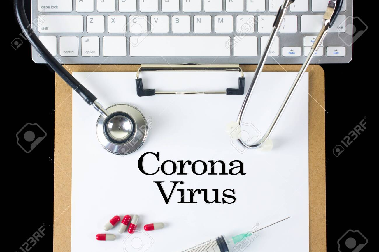 CORONA VIRUS word written on blackboard with Stethoscope, Pills, keycoard on wood background - 143214735