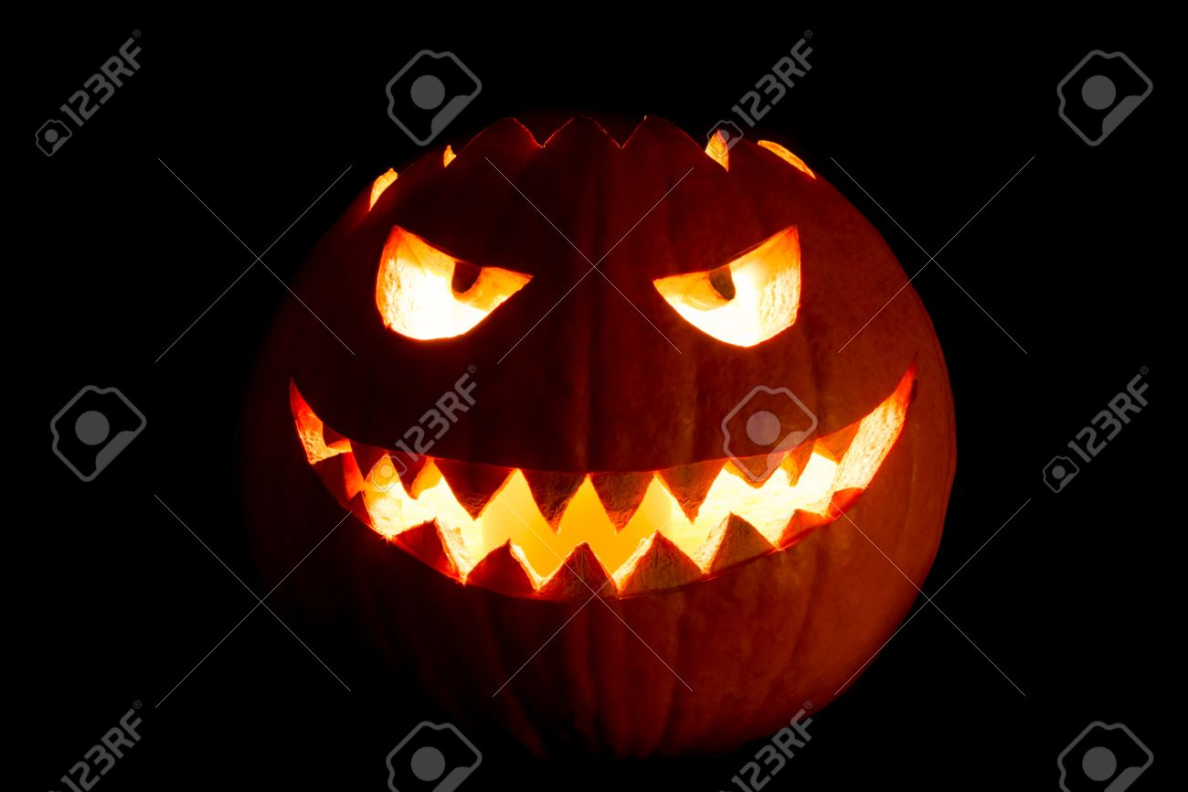 Round Halloween Pumpkin Smile With Hot Burning Fire Eyes Mouth. The Big  Helloween Symbol Has