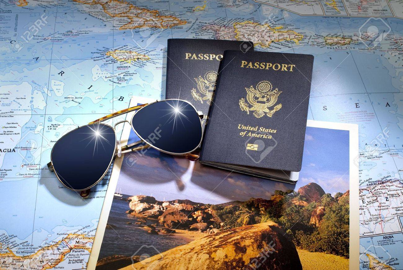 Two Us American Passports And Sungl Over Map Of Caribbean Stock Photo 7485050