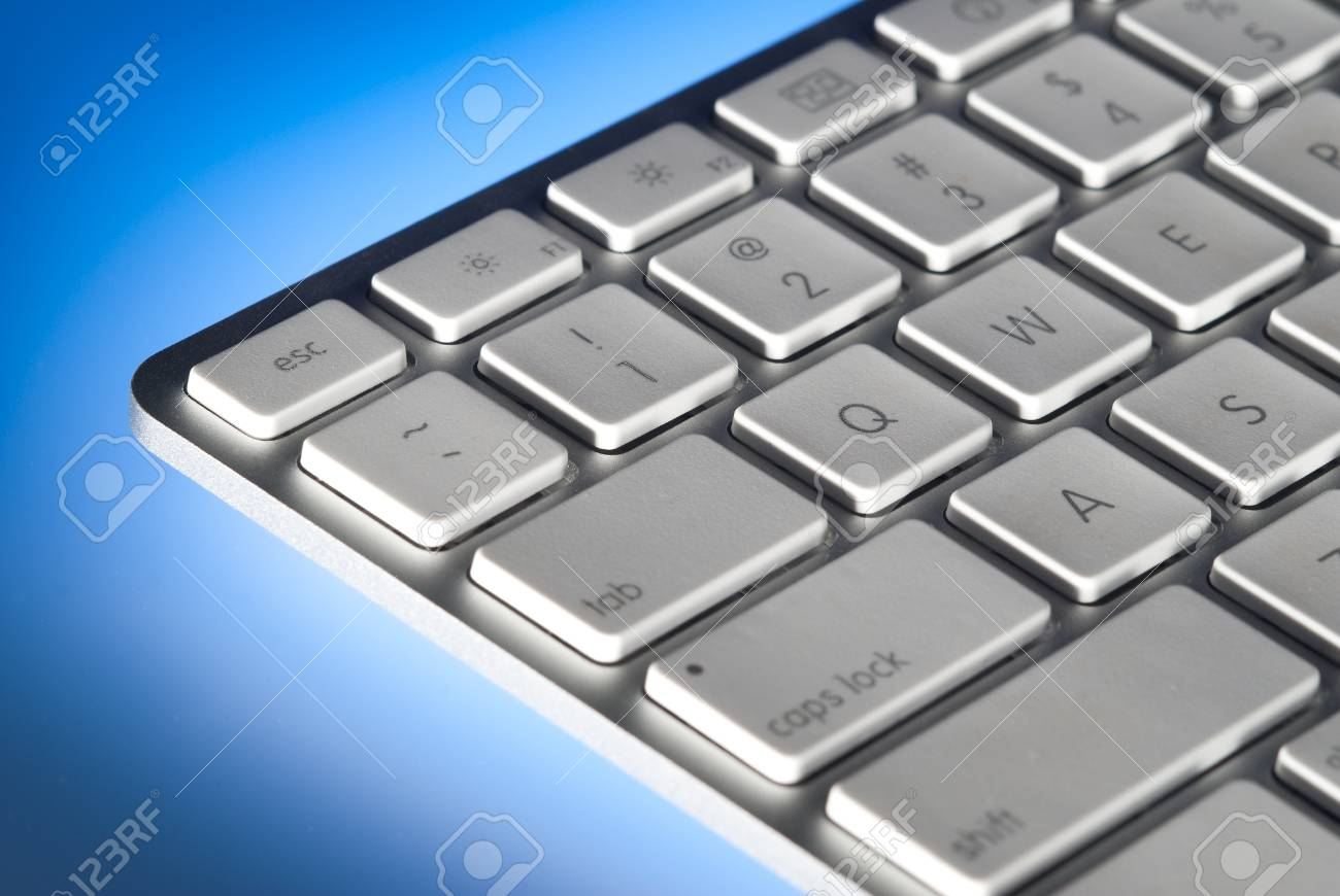Computer keyboard close-up and back lit with limited depth of field Stock Photo - 9940139