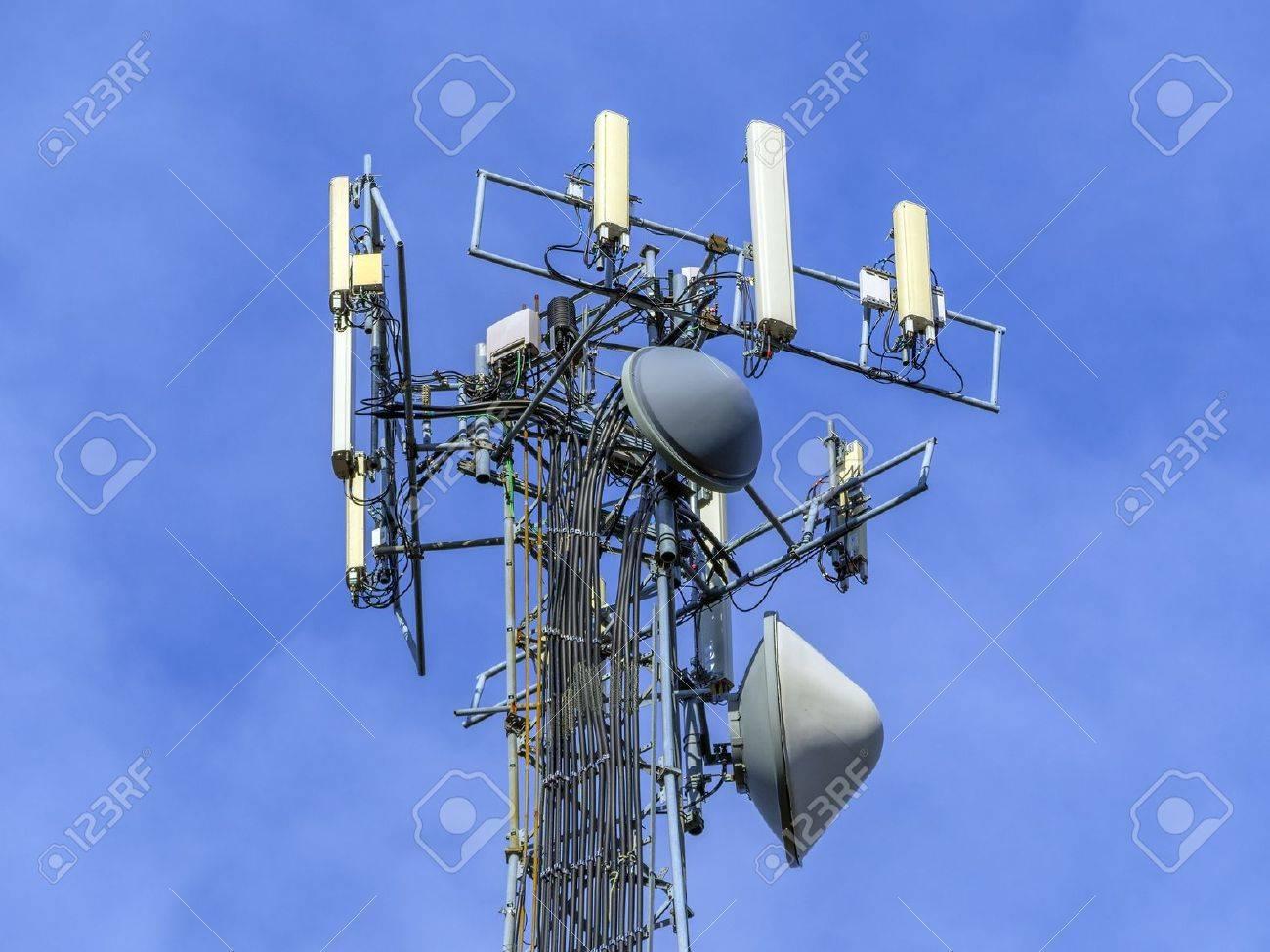 Telecommunications equipment - directional mobile phone antenna dishes. Wireless communication. Stock Photo - 17018804