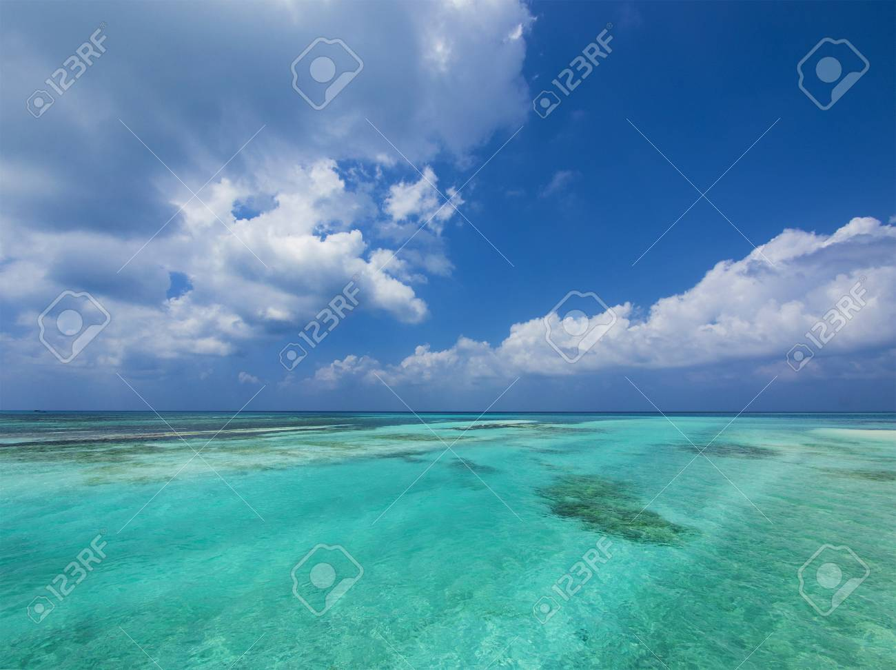 Tropical aquamarine sea and clouds in paradise Stock Photo - 17884059