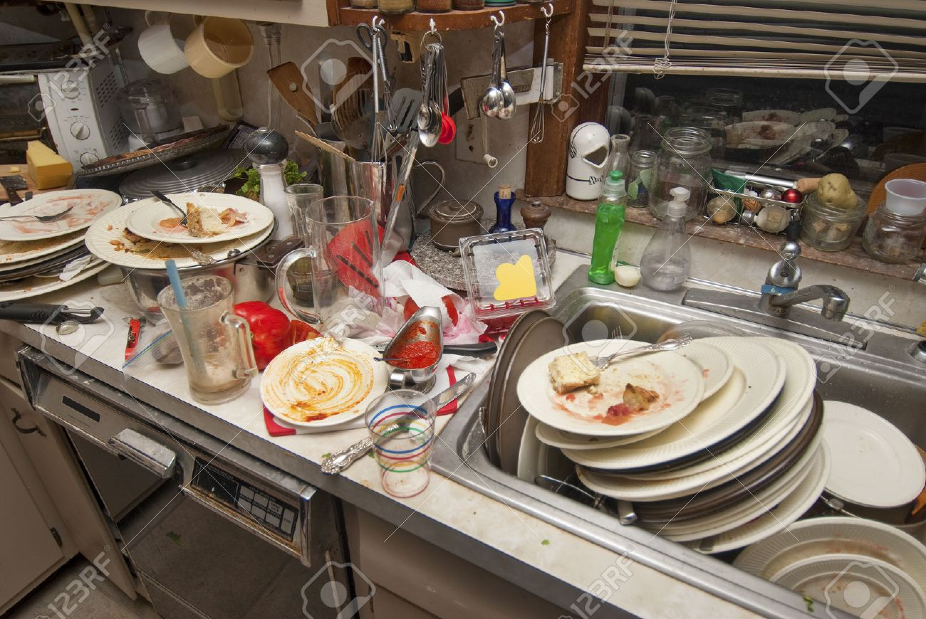 Dirty Dishes Over Flowing In A Kitchen Sink Stock Photo, Picture And ...