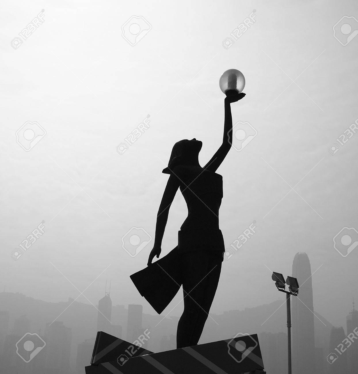 Woman silhouette raise hand Stock Photo - 9855424