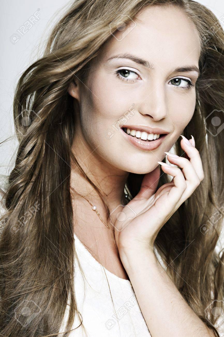 beautiful smiling girl with long wonderful hair Stock Photo - 10909879