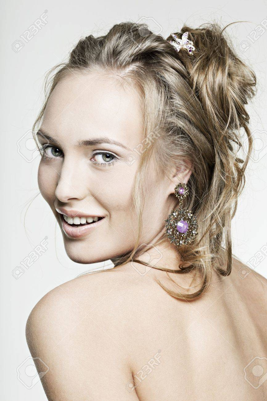 beautiful face smiling girl with perfect skin wearing jewelry Stock Photo - 10909878