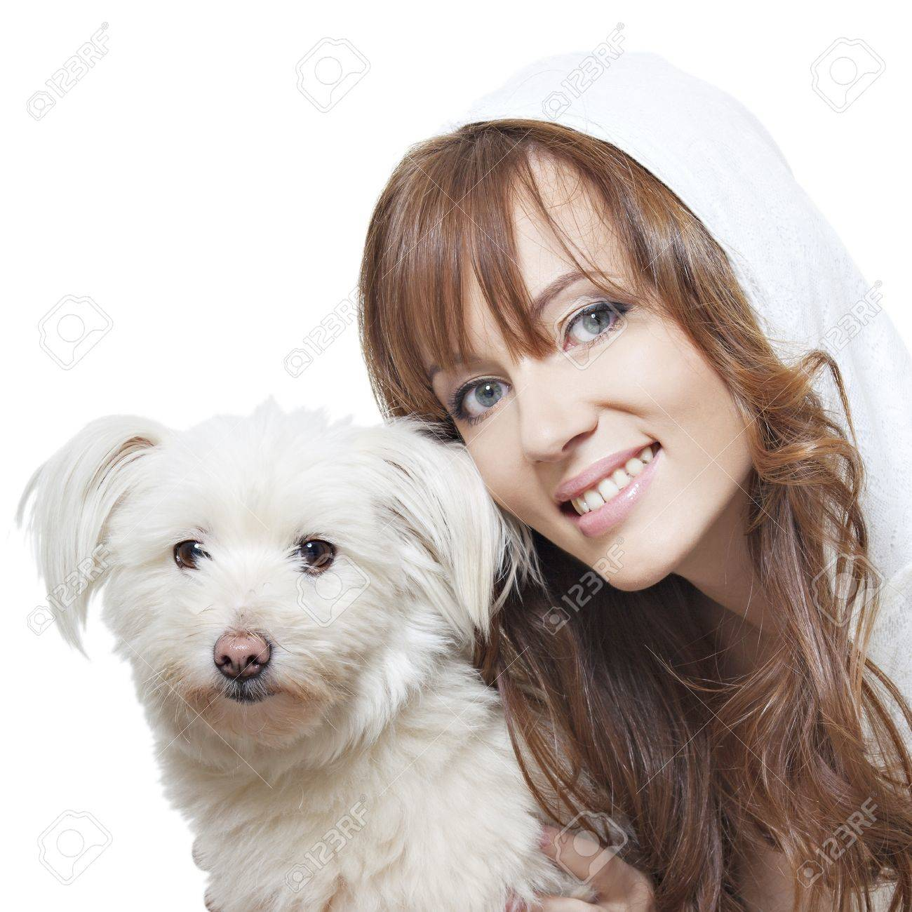 beautiful smiling girl with perfect skin with a fluffy white dog on a white background Stock Photo - 10909868
