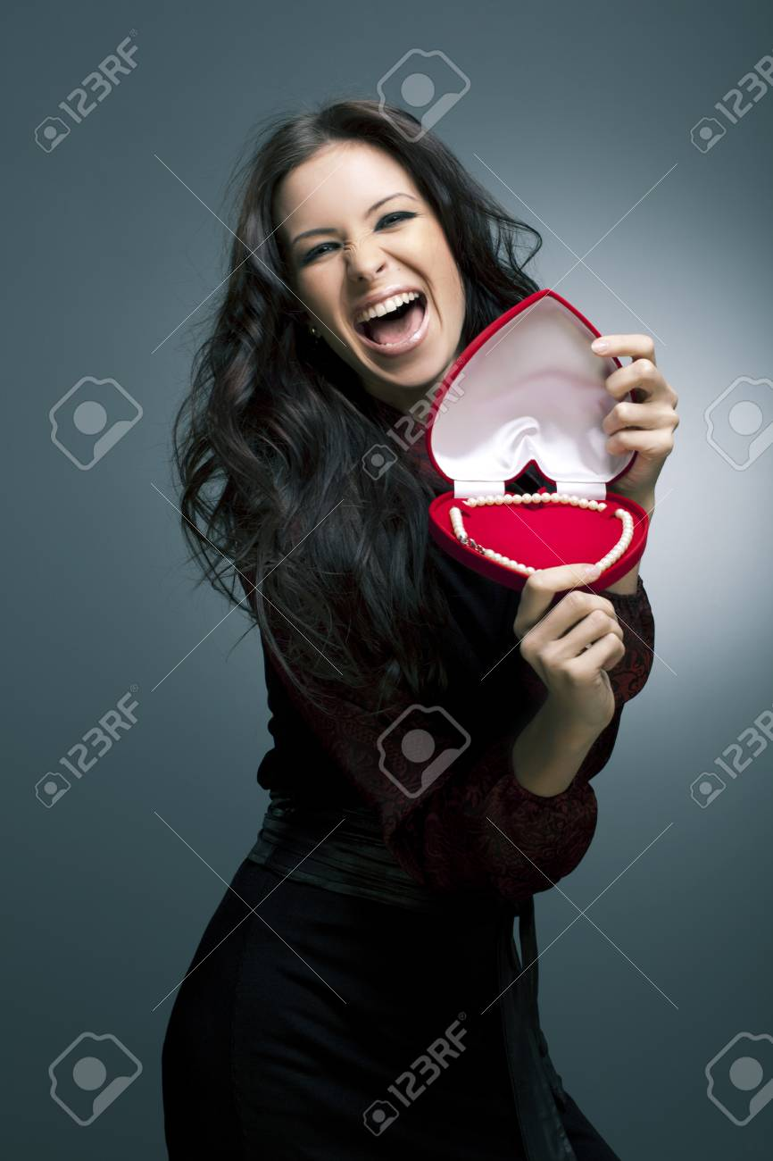 Valentine s Day  Beautiful smiling woman with a gift in the form of heart in his hands Stock Photo - 12840144