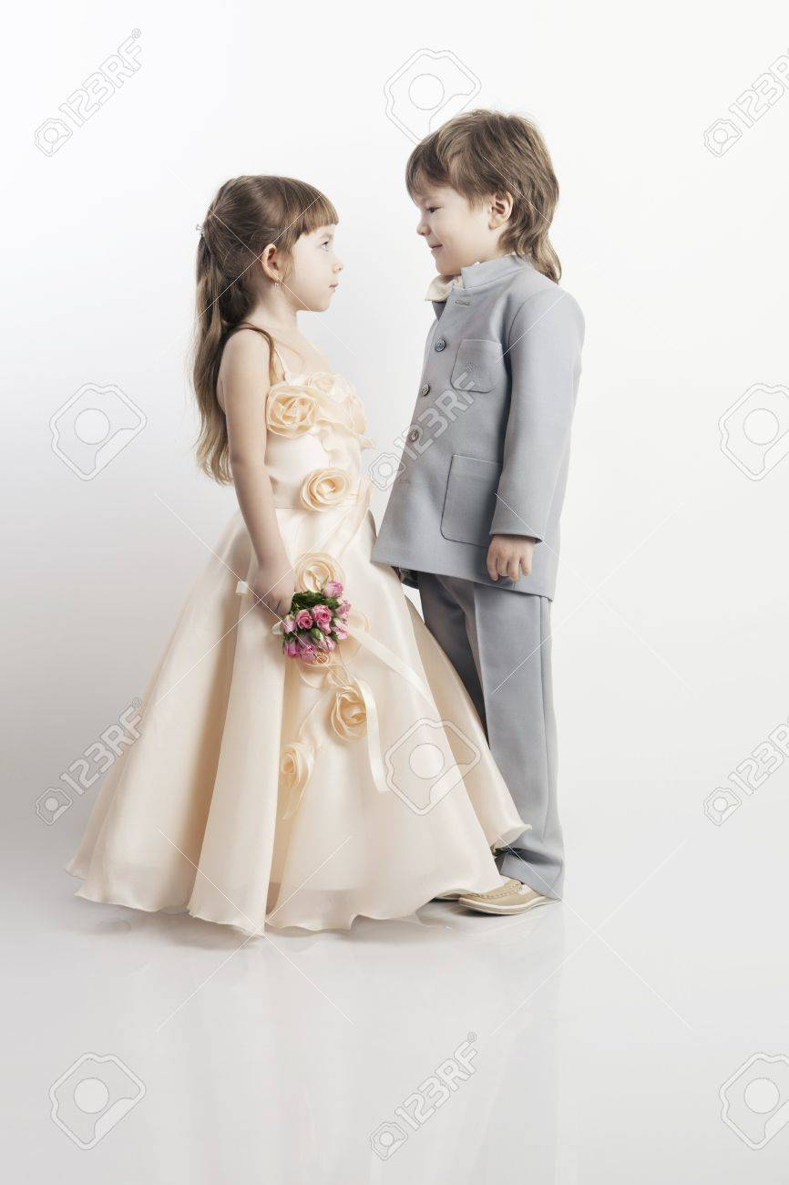 Portrait Of Two Beautiful Little Boys And Girls In Wedding Dresses ...