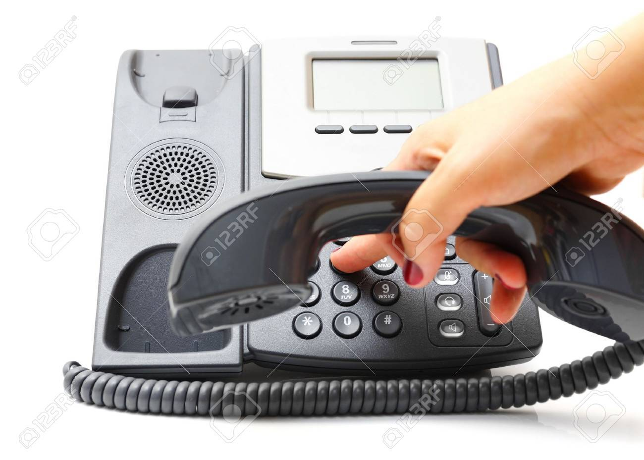 woman hand is dialing a phone number Stock Photo - 21455402