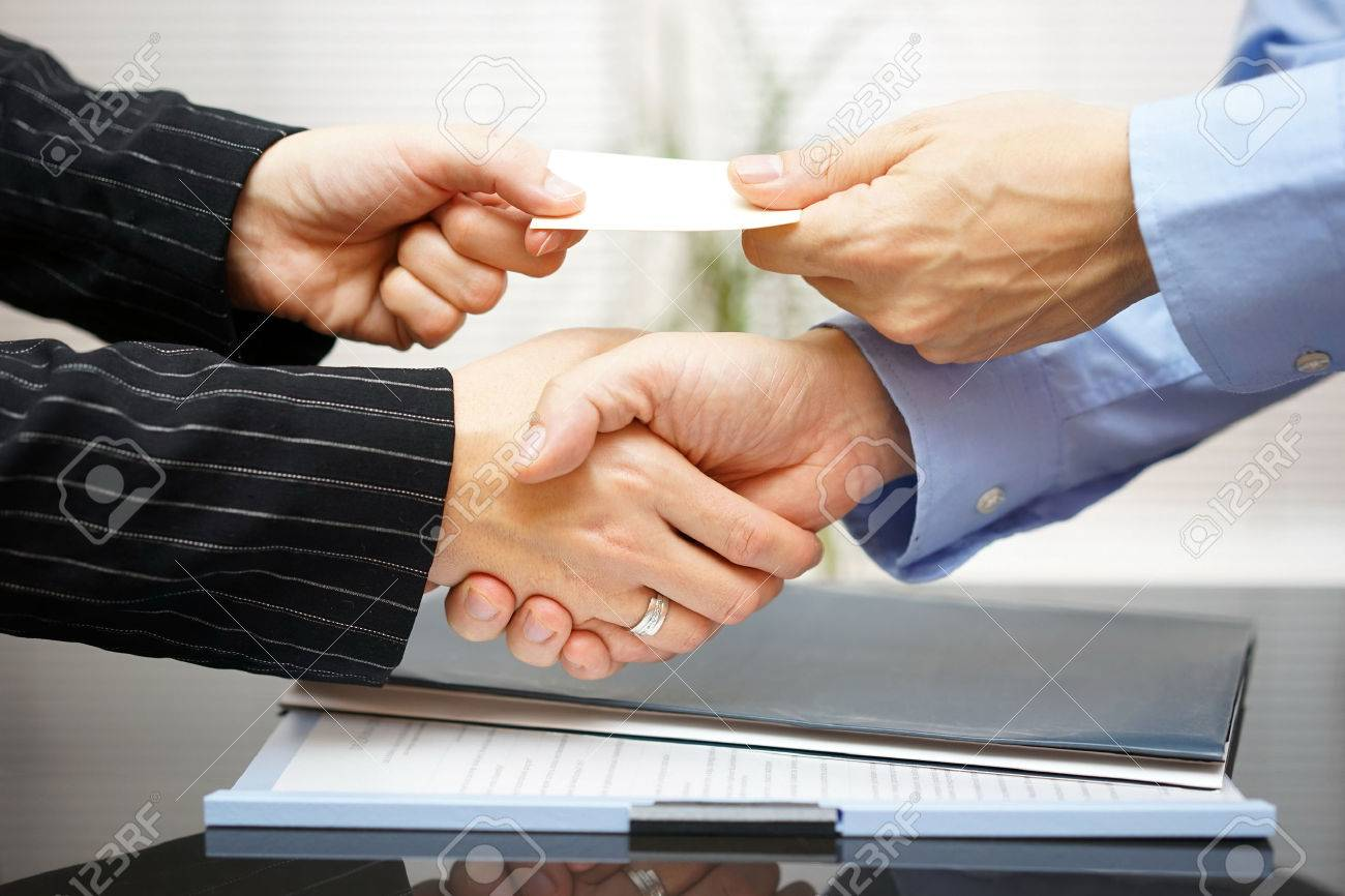 Business clients are exchanging business card and handshakeing business clients are exchanging business card and handshakeing after successful meeting stock photo 33943981 colourmoves