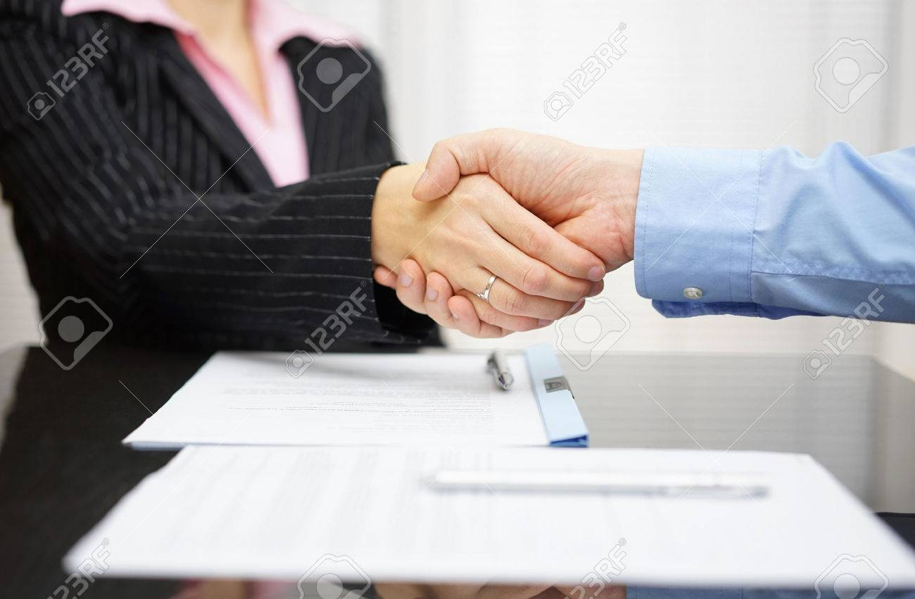 Business Partner And Client Are Handshaking Over Signed Contract ...