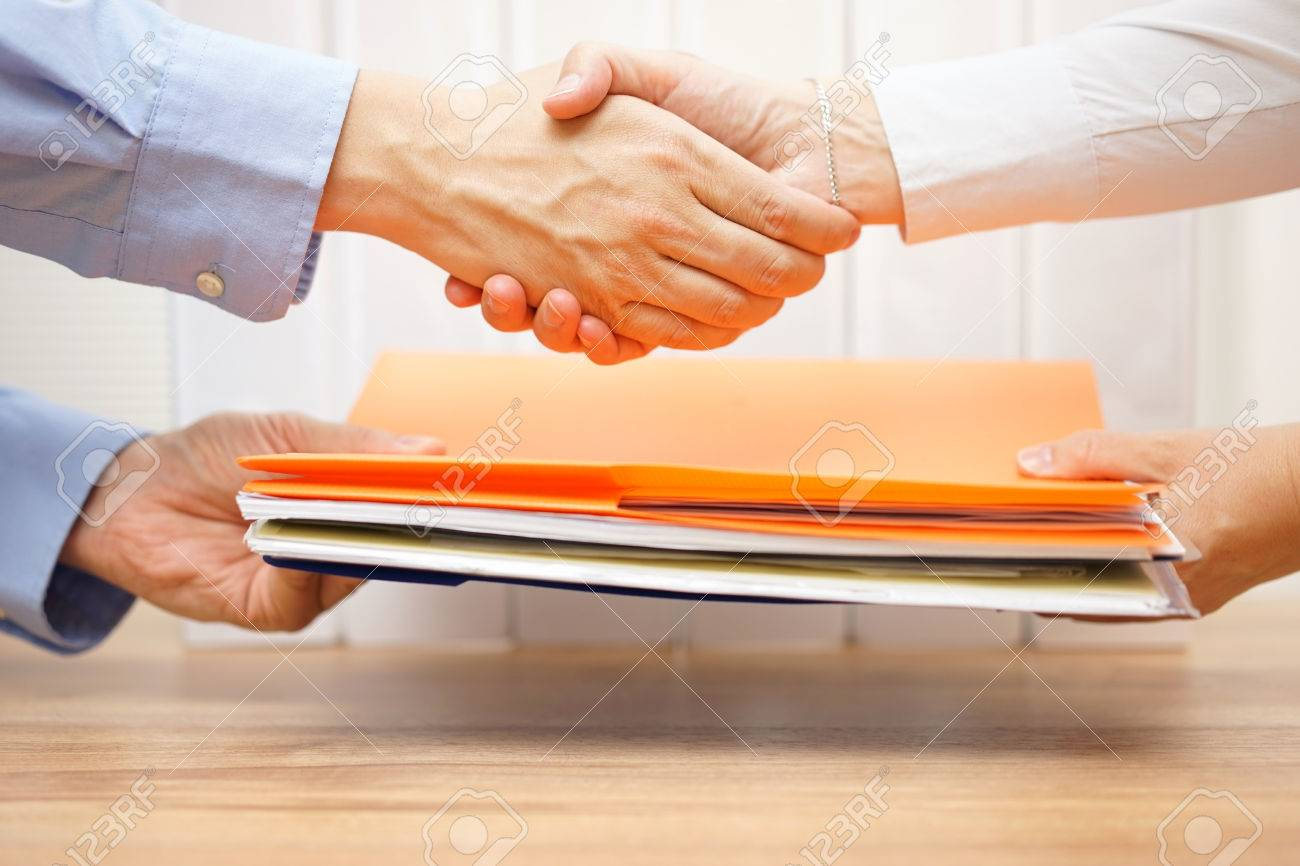 entrepreneur shaking hands with his accuntant after passing documenation and invoices - 44683822